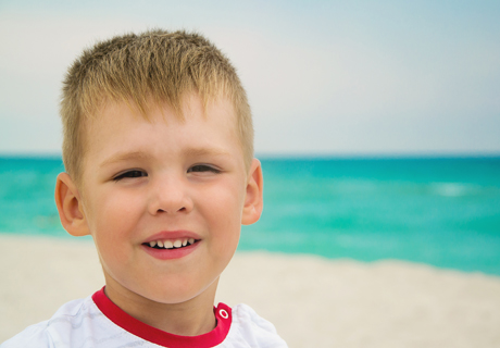 A young boy enjoys a day at the beach.