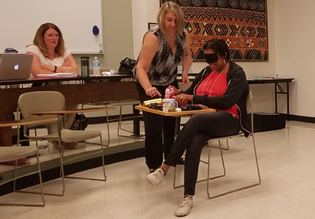 A Summer Institute participant experiences what it is like to be blind in a classroom.